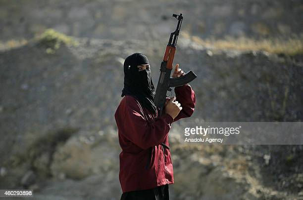 A policewoman holding a kalashnikov during a commando training in Hakimabad district of Nowshera Pakistan on December 10 2014 A group of volunteer...