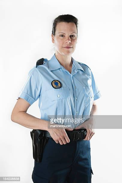 Policewoman in summer shirt on white background, vertical.