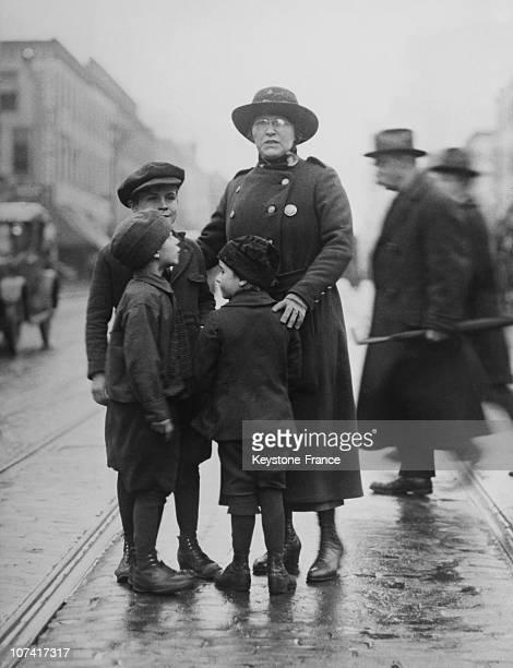 Policewoman Protecting Children Against Traffic Dangers In New York 237edb7e1e77