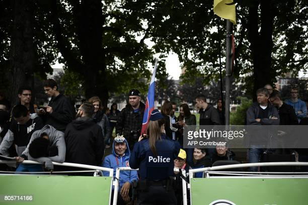 A policewoman stands guard near the finish line at the end of the 2035 km second stage of the 104th edition of the Tour de France cycling race on...