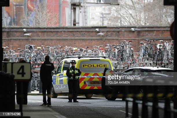 A policewoman stands guard outside a police cordon at Waterloo Station central London on March 5 following a report of a suspicious package at the...
