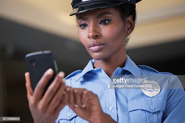 Policewoman using smartphone