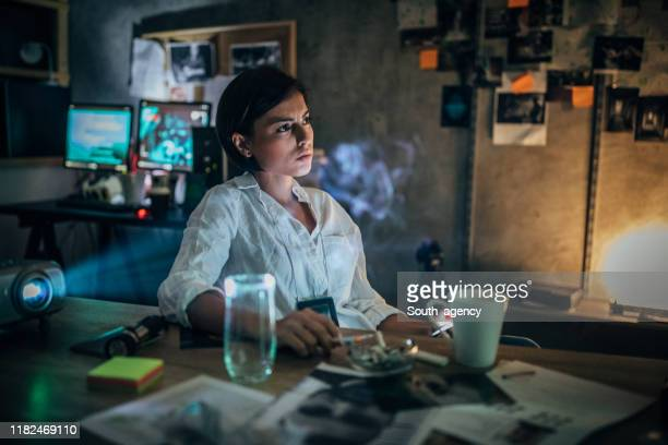 policewoman working late - criminal investigation stock pictures, royalty-free photos & images
