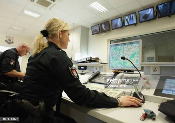 A policewoman works at the control center at a police station on December 9 2010 in Hamburg Germany The police officer receives emergency calls and...