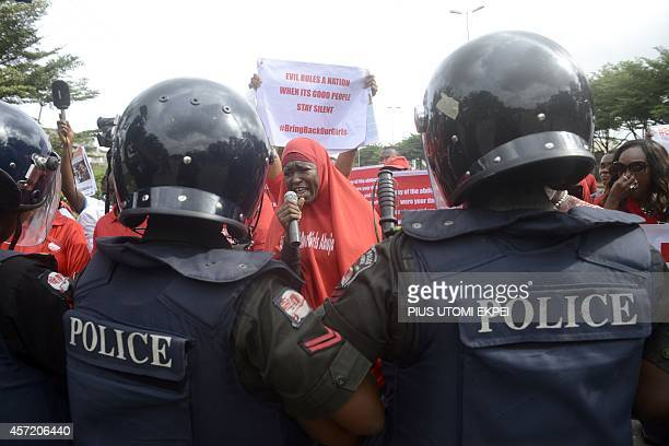 Policewomen block supporters of the #BringBackOurGirls campaign who ask for the release of the 219 Chibok schoolgirls kidnapped by Boko Haram...