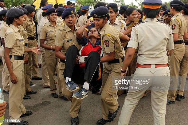 Policewomen carrying candidate injured during the outdoor tests during a police recruitment drive on June 24 2014 in Mumbai India So far four...