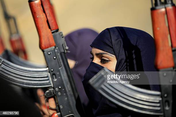 Policewomen holding kalashnikovs during a commando training in Hakimabad district of Nowshera Pakistan on December 10 2014 A group of volunteer...