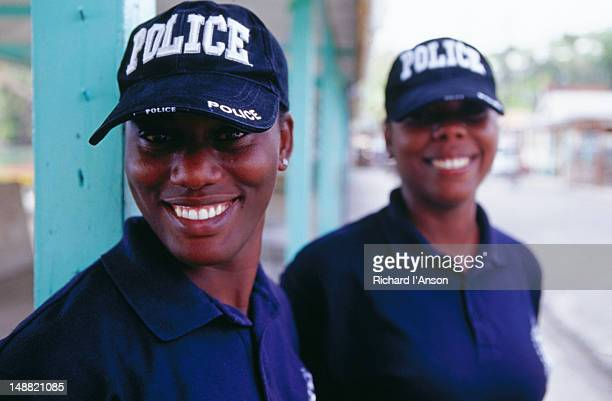 policewomen in anse la raye village. - raye stock pictures, royalty-free photos & images