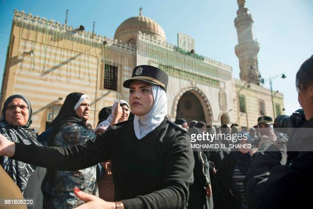 Policewomen organise mourners attending the funeral of the late popular singer and actress Shadia at the Sayeda Nafisa mosque in the capital Cairo on...