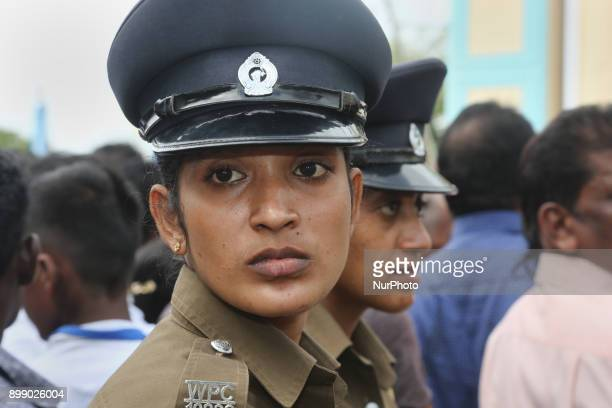Policewomen watch over the massive crowd of pilgrims at the Shrine of Our Lady of Madhu during the Feast of Our Lady of Madhu in Mannar Sri Lanka...
