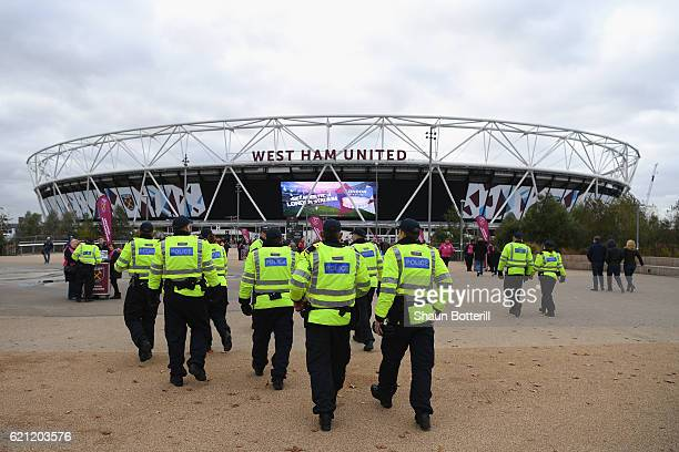 Policing measures are seen outside the stadium prior to the Premier League match between West Ham United and Stoke City at Olympic Stadium on...