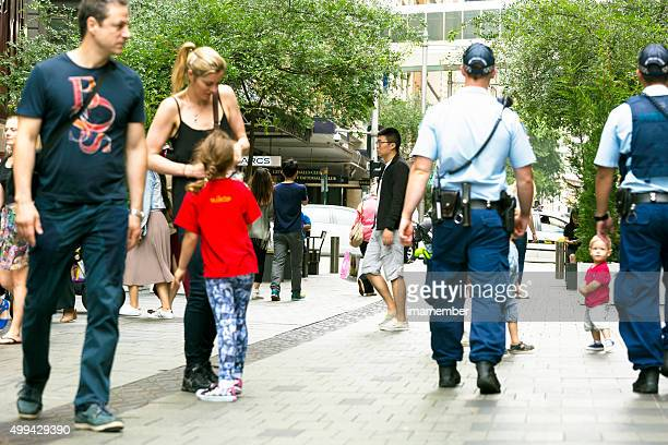 Policmen on duty patrol street in Sydney Australia