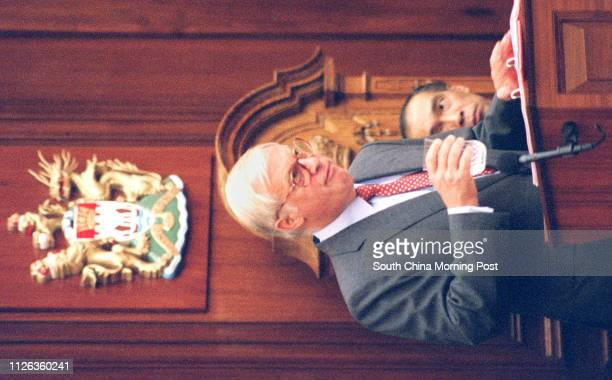 Policy address by Governor at Legco Governor Chris Patten having a glass of water while Andrew Wong watching him 11 Oct 95