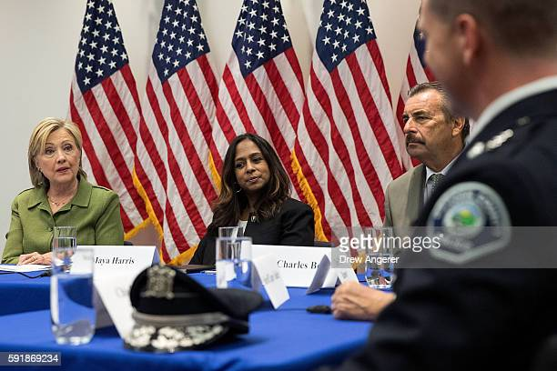 Policy advisor Maya Harris looks on as Democratic presidential candidate Hillary Clinton delivers opening remarks during a meeting with law...
