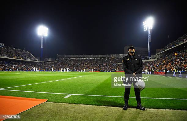 A polie officer stands patrols pitchside during the international friendly match between Spain and England at Jose Rico Perez Stadium on November 13...
