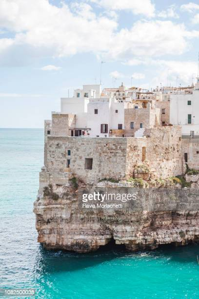 polignano a mare buildings facing adriatic sea - coastline stock pictures, royalty-free photos & images
