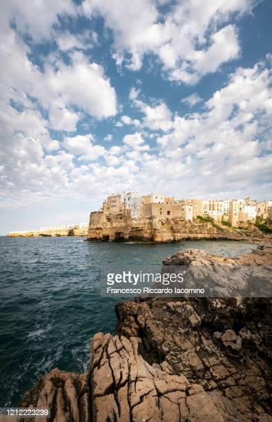 polignano a mare in a sunny summer day, apulia, southern italy. - bari foto e immagini stock