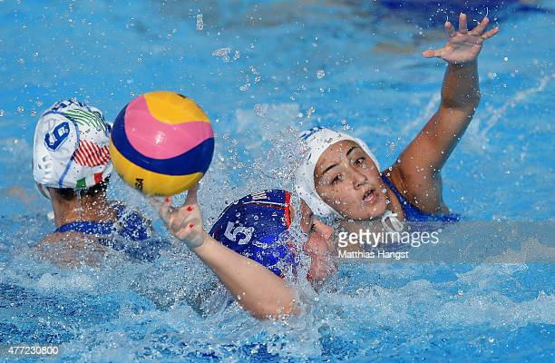 Polina Kempf of Russia battles for the ball with Giulia Millo of Italy and Chiara Foresta of Italy during the Womens' Water Polo Group B match...