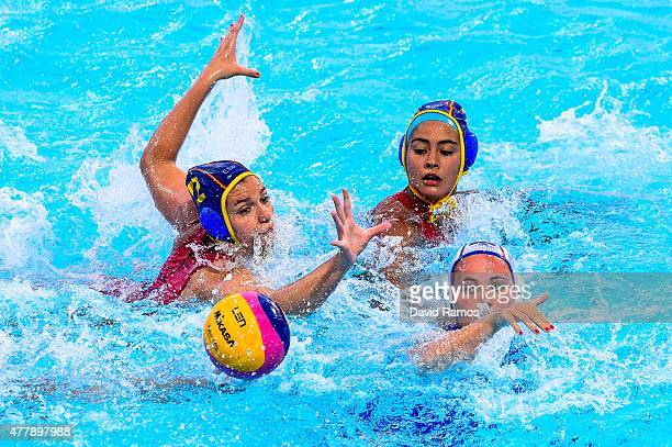 Polina Kempf of Russia vies for the ball with Anna Roldan and Paula Crespi of Spain in the Women's Waterpolo Final during day eight of the Baku 2015...