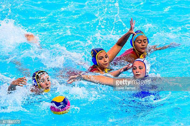 Polina Kempf of Russia vies for the ball with Mireia Guiral Anna Roldan and Paula Crespi of Spain in the Women's Waterpolo Final during day eight of...