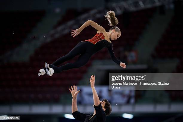 Polina Kostiukovich and Dmitrii Ialin of Russia compete in the Junior Pairs Short Program during the World Junior Figure Skating Championships at...