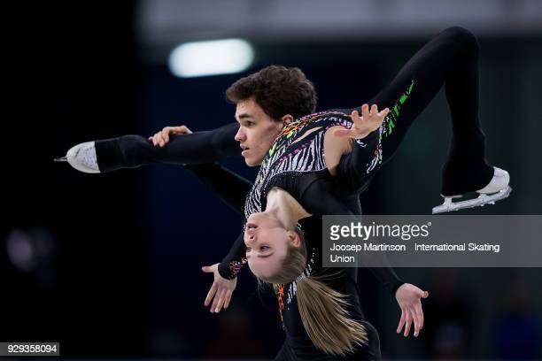 Polina Kostiukovich and Dmitrii Ialin of Russia compete in the Pairs Free Skating during the World Junior Figure Skating Championships at Arena...