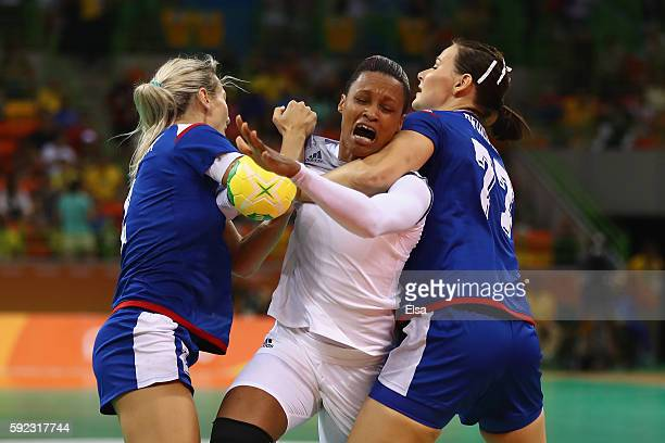 Polina Kuznetsova and Mayya Petrova of Russia block Allison Pineau of France during the Women's Handball Gold medal match between France and Russia...