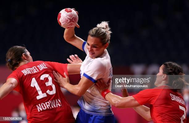 Polina Kuznetsova of Team ROC runs with the ball while under pressure from Kari Brattset Dale and Stine Skogrand of Team Norway during the Women's...
