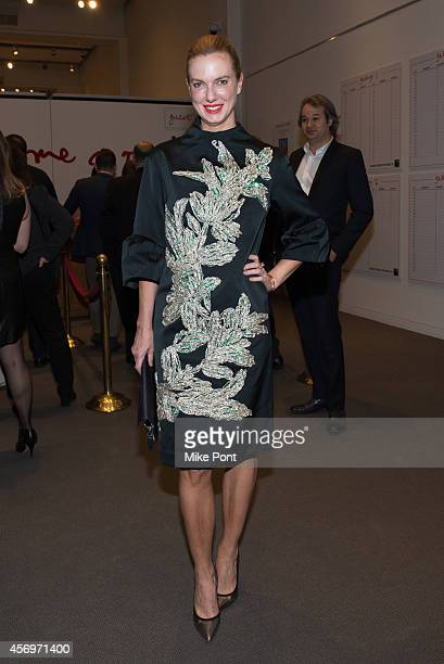 Polina Proshkina attends the 2014 Take Home A Nude Event at Sotheby's on October 9 2014 in New York City