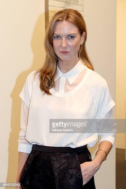 Polina Proshkina wearing a Tibi top Balenciaga shorts an Alexander Wang bag Givenchy shoes and Cartier jewelry attends Art Basel Miami BEach 2013 at...