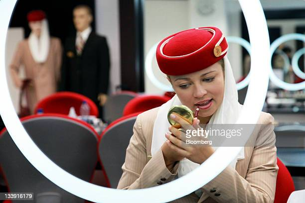 Polina Sasko an aircrew student with Emirates Airline applies lip liner during a makeup training session at the Emirates Aviation College in Dubai...