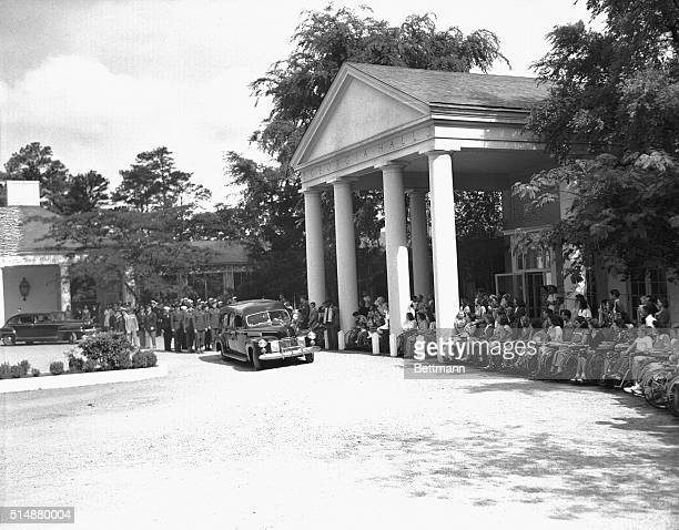 Polio patients and men of the Marine Honor Guard are shown lined up before Georgia Hall at the Warm Springs Foundation as the body of Franklin D...