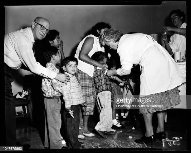 Polio shots 1 May 1957 Eliza RuizMelvin Ruiz 1 yearDr Maude HilliardRachel HermosilloMrs Doris CloudJudy TibbettCarole LuskCaption slip reads...