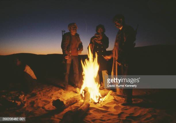 SAHARA 1973 Polisario rebels warm themselves during an operation against the Moroccan army somewhere in the Western Sahara Desert 1973 The Polisario...