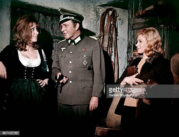 Polish actress Ingrid Pitt Welsh actor Richard Burton and Scottish actress Mary Ure on the set of Where Eagles Dare directed by Brian G Hutton