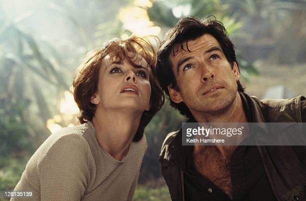 Polish actress Izabella Scorupco films a jungle scene with Irish actor Pierce Brosnan for the James Bond film 'GoldenEye' 1995