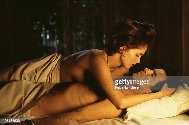 Polish actress Izabella Scorupco films a love scene with Irish actor Pierce Brosnan for the James Bond film 'GoldenEye' 1995