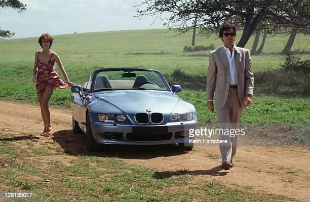 Polish actress Izabella Scorupco films a scene in Puerto Rico with Irish actor Pierce Brosnan and a BMW Z3, for the James Bond film 'GoldenEye', 1995.