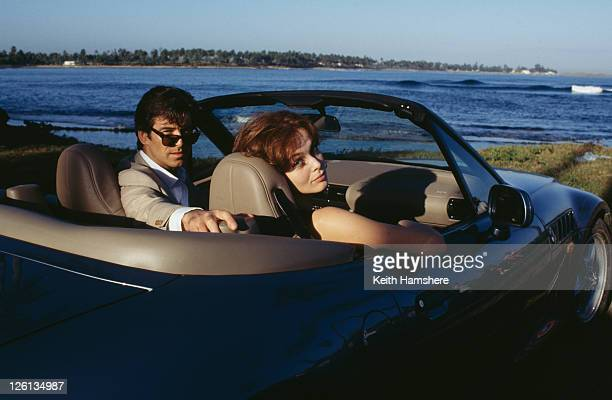 Polish actress Izabella Scorupco films a scene with Irish actor Pierce Brosnan and a BMW Z3 in Puerto Rico for the James Bond film 'GoldenEye' 1995