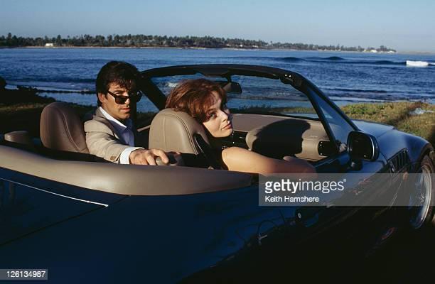 Polish actress Izabella Scorupco films a scene with Irish actor Pierce Brosnan and a BMW Z3 in Puerto Rico, for the James Bond film 'GoldenEye', 1995.