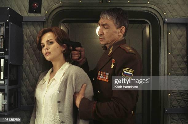 Polish actress Izabella Scorupco is captured by German actor Gottfried John as General Ourumov in the James Bond film 'GoldenEye' 1995