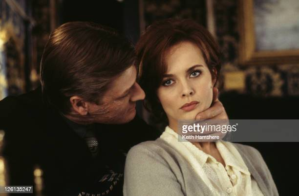 Polish actress Izabella Scorupco is menaced by English actor Sean Bean as the treacherous Alec Trevelyan in a scene from the James Bond film...