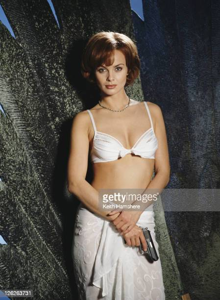 Polish actress Izabella Scorupco stars as computer programmer Natalya Simonova in the James Bond film 'GoldenEye' 1995 She is holding Bond's iconic...