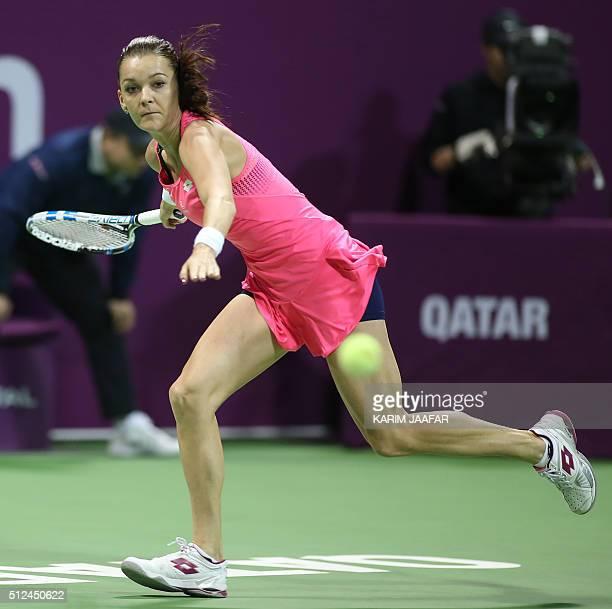 Polish Agnieszka Radwanska returns the ball to Spanish player Carla Suarez Navarro during their Qatar Open semifinal tennis match on February 26 2016...