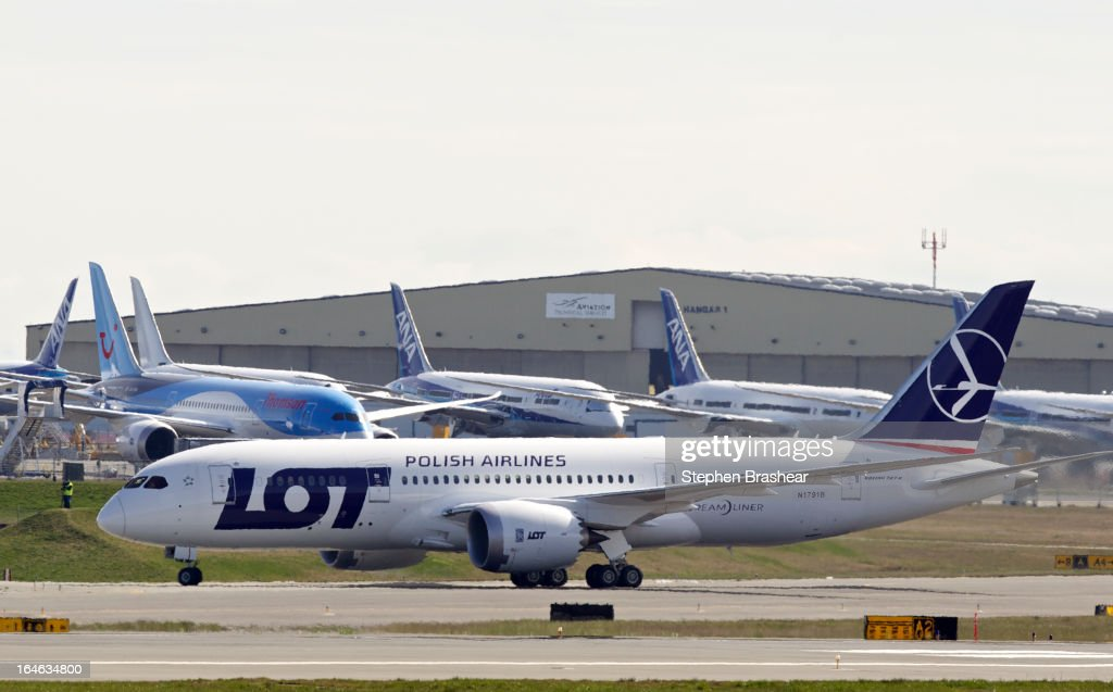 Polish Airlines Boeing 787 Dreamliner with a redesigned lithium ion battery taxis in front of a row of 787 airliners after landing during a test flight March 25, 2012 at Paine Field in EVERETT, WA. The 787 has been grounded since January after problems with the lithium ion battery.