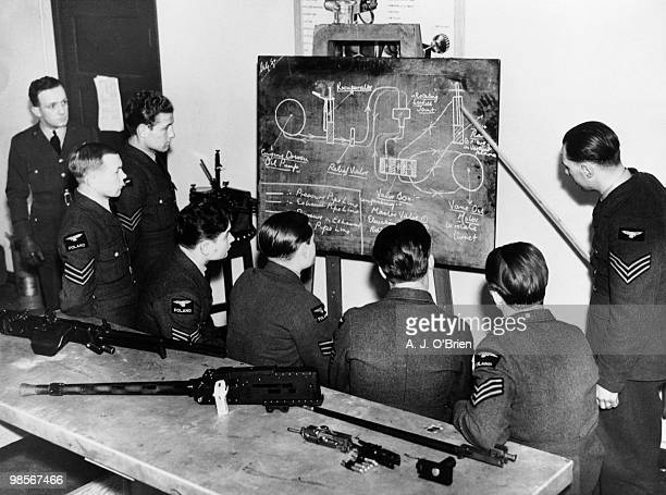 Polish airmen receive instruction in armoury at an RAF station during World War II, 20th December 1940. Once trained, they will fight alongside the...