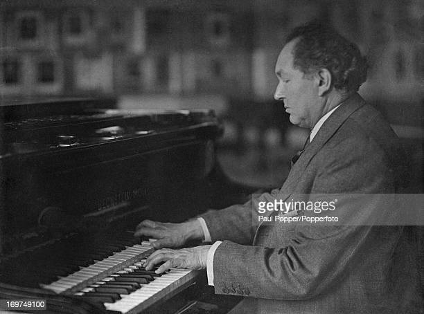 Polish American pianist composer and teacher Leopold Godowsky at a piano circa 1935