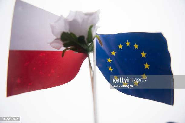 A polish and European Union flags are seen during a silent assembly named Stolen Justice in Krakow Stolen Justice happening intend to express...