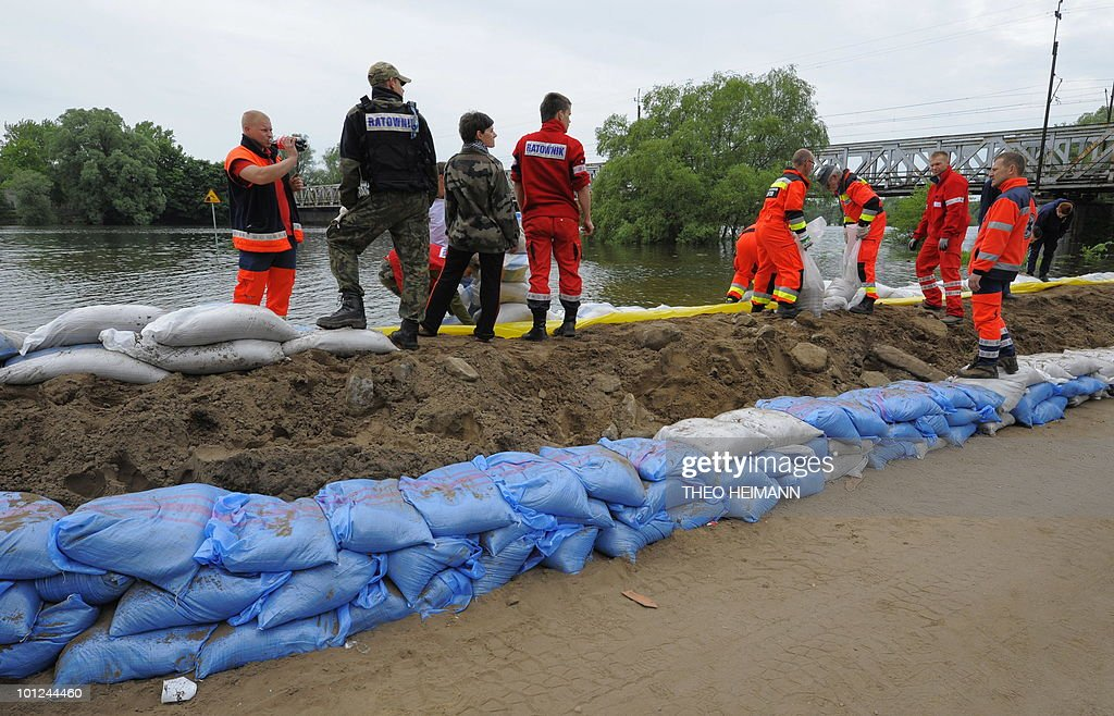 Polish and German helpers built a dike of sand sacks near the Polish town of Kostrzyn on May 28, 2010. Torrential rain in Poland's mountainous south have caused rivers swell and the flood warning level has risen in Germany.