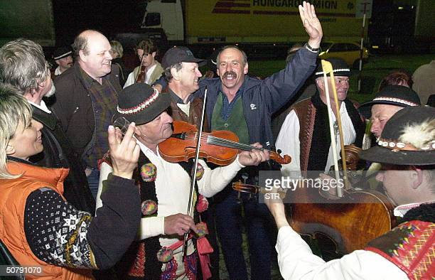 Polish and Slovak citizens celebrate the EU entry shortly after border barrier was cut between Poland and SLovakia at midnight 01 May 2004 at border...